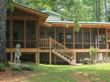 Lake Martin cabin rental - Screened in porch with easy direct stair access to the beach