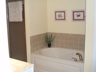 Vacation Homes in Ocean City condo photo - Master bathroom w/jetted tub & separate shower