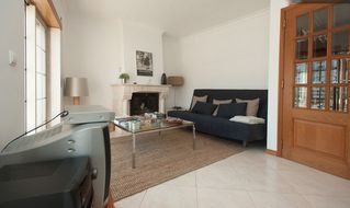 Estoril apartment photo - Comfortable and spacious living room (with a plasma TV this year)