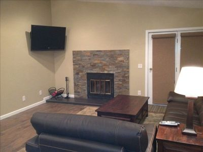 All new flooring, flat screen, tables, couch & chair