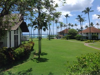 View from lanai across lawn to Poipu Beach.