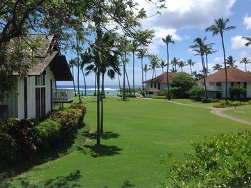 Poipu condo rental - View from lanai across lawn to Poipu Beach.