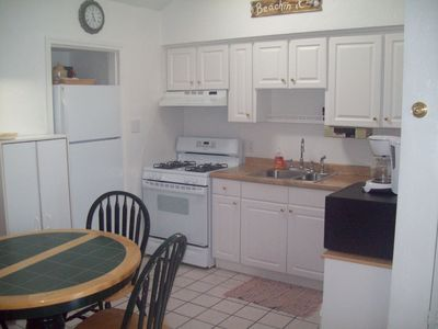 view of will stocked kitchen and table