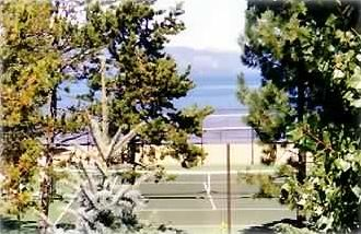 View from master bedroom & 2nd story balcony of the tennis courts & Lake Tahoe.