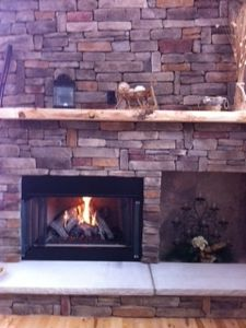 Fireplace with gas logs and limestone hearth