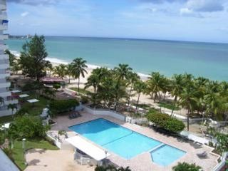 Isla Verde condo photo - Balcony view of the beach and pool just below