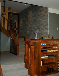 Stairs to kitchen, bedroom to the left of landing. Book shelf stocked with games