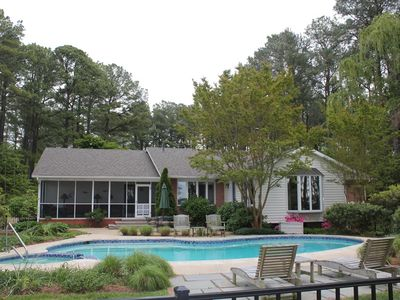 Four bedroom house is VERY spacious. Refresh in the pool or on shady porch!