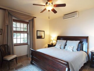 Peter Bay villa photo - The lower guest house bedroom has pool views as well as ocean views north.