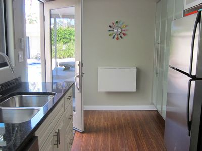 Casita kitchenette with full size refrigerator, sink, dishwasher, and microwave.