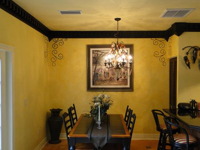 Dentil moulding adds style to living and dining area.