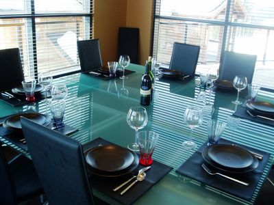Crescendo's Dining Room table: solid glass (as are the table's extensions).