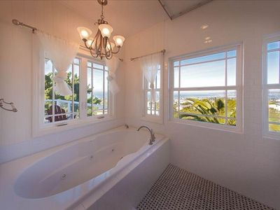 Upstairs bath w/ Marble tile and jacuzzi tub for two with breathtaking views.