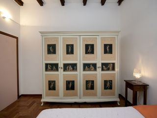 Bologna apartment photo - Master bedroom - a 1700's cabinet.