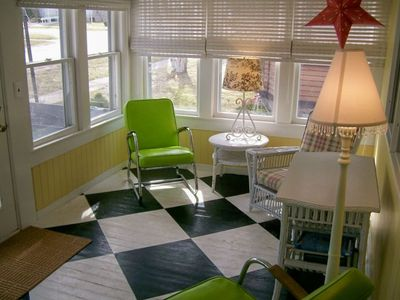 The Enclosed Front Porch Has Screens and Blinds
