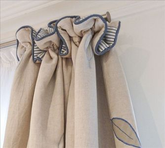 Beautiful touches throughout, such as beige linen curtains & blue stripe lining