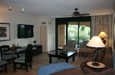 Living room with oceanview balcony and 54 inch plasma TV