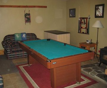 Game room with Pool Table, Wood Stove, and Queen Sofa Sleeper