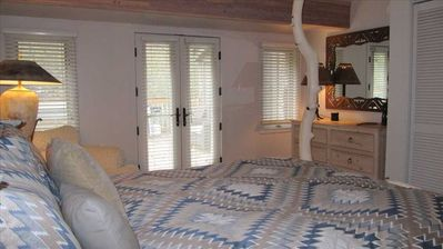 Master Suite w/ French Doors opening to Private Deck & Hot