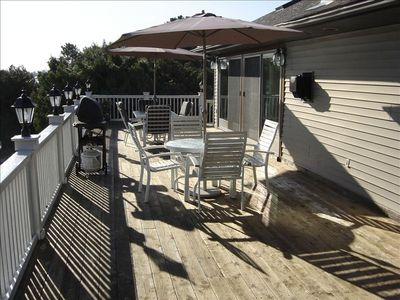 Upper Unit Deck with 2 Lawn Furniture Sets and Grill.