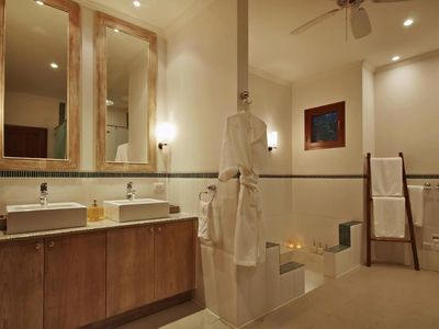 Cool chic guest bathroom with huge bath, rain shower and his 'n hers sinks