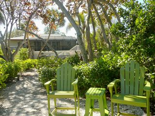 Sanibel Island house photo - Rear view of our home & very private tropical yard from our river sitting area!