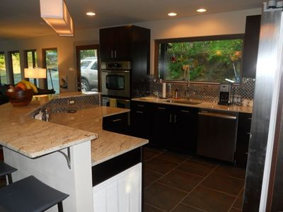 kitchen with double oven, granite countertops, window to watch hummingbirds