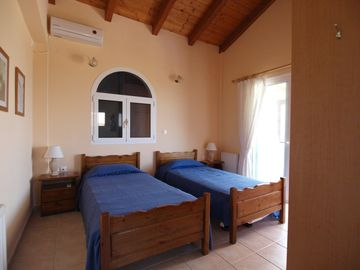 Main Bedroom with Balcony Overlooking Pool