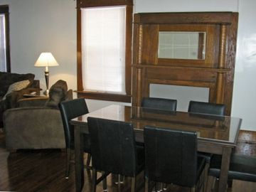 Lots of seating in Dining Room with classic wood fireplace