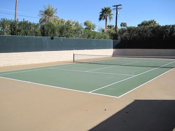 Private tennis court with electronic ball machine. Rackets and balls provided.