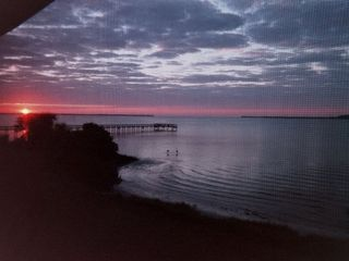Port Charlotte condo photo - Pier for Harbour Village - taken at sunrise from our lanai.