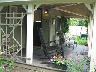 Warwick cottage photo - The porch is ideal for coffee, a glass of wine, or just a quiet rock & read.