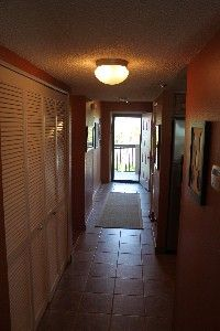 Hallway to front door (which is screened) allows light.