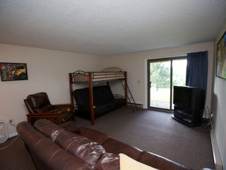 Burke condo photo - Lower level, twin over full futon bunk. TV with DVD and Wii