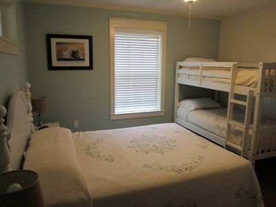Queen bed and set of bunks. TV with DVD player.