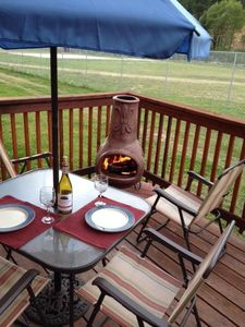 Back deck; wood burning chimenea; The red river is behind and great sunset view!