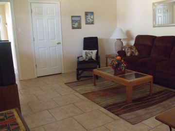Comfortable living room. Couch reclines on both ends