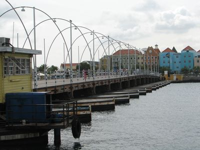 Explore the famous floating market of Willemstad and Walk the Pontoon bridge