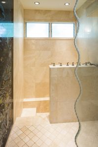 Master bathroom has waterfall shower