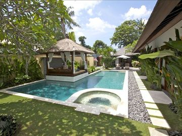 Private swimming pool with jacuzzi and gazebo