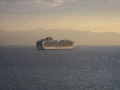 A cruise ship on their way out of port viewed from our balcony.