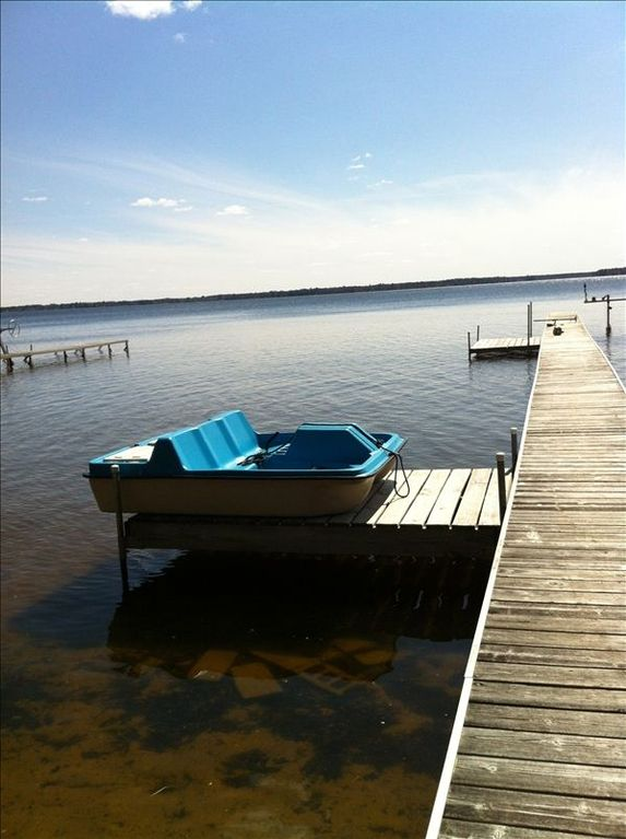Cadillac cottage rental - Long dock with extra boat dock or sunning deck. Paddle your way around the lake