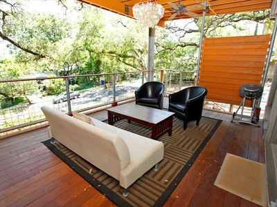 Private Lanai with fans, wood deck and grill.