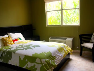 The green guest room with queen size bed