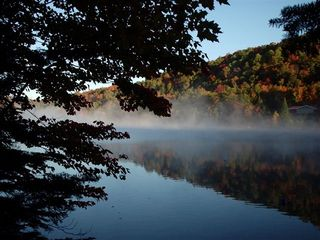 Saint-Sauveur cabin photo - Early morning mist. View from lakeside campfire circle.