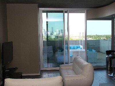 Condo opens up to terrace space with a breathtaking downtown view!
