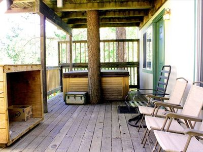 Sierra Tract house rental - BBQ and Hot tub on a large first story deck that sits 10 feet above the meadow.