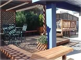 Backyard Deck with Patio Furniture,Gas BBQ Grill, and Fish Pond