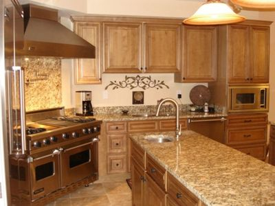 Open Kitchen with stainless Viking Appliances and Granite throughout