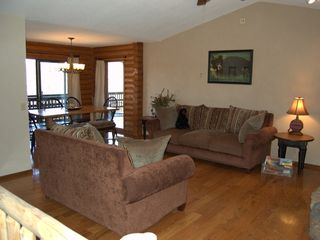 Branson cabin photo - Living Room open into dining & large covered deck